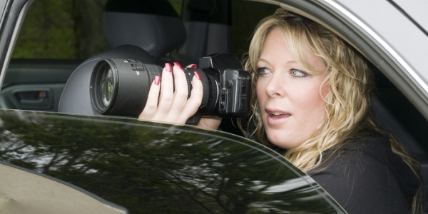woman investigator taking photos in a car