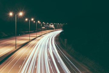 busy highway at night with light streaks for cars