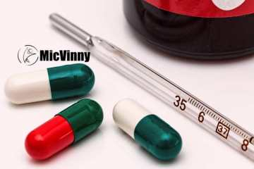 thermometer with pills and MicVinny logo