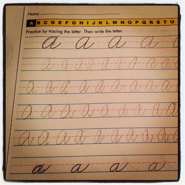20121113 Madame Oui practices cursive writing