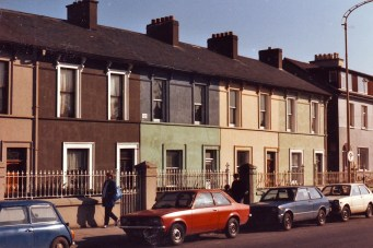Housing in Cork, Ireland. Notice painted sides of houses.