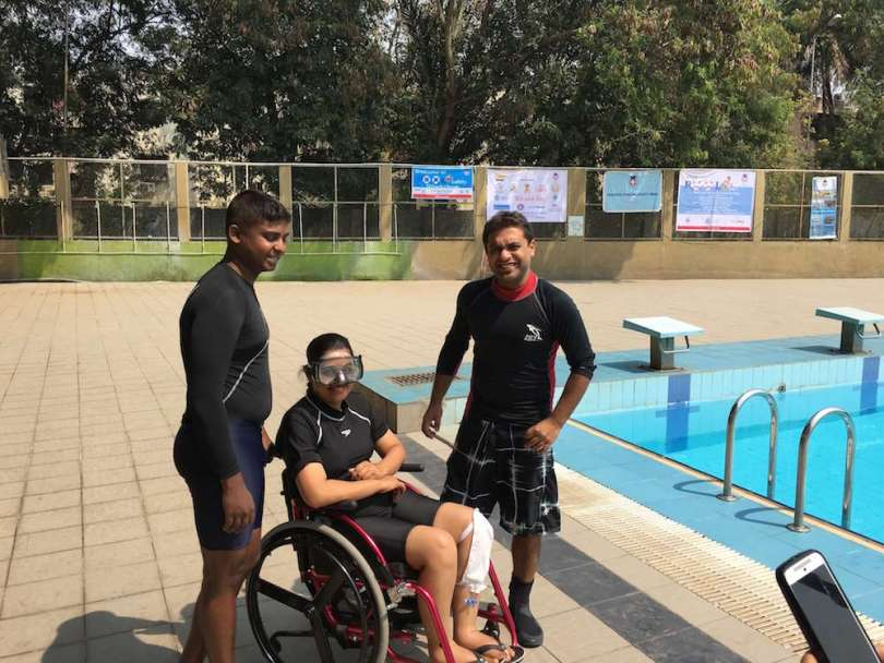 Just before entering the pool - Kshitiz and another coach