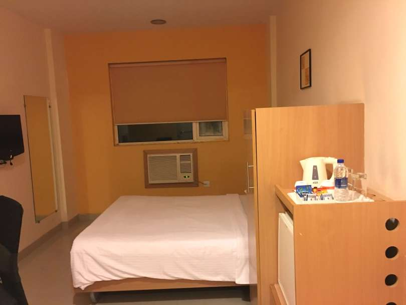 The twin bed inside the accessible room
