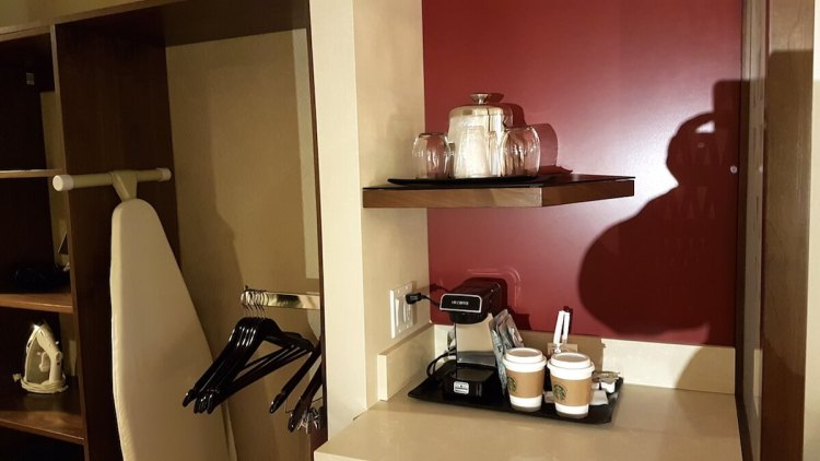Coffee machine and open wardrobe inside the