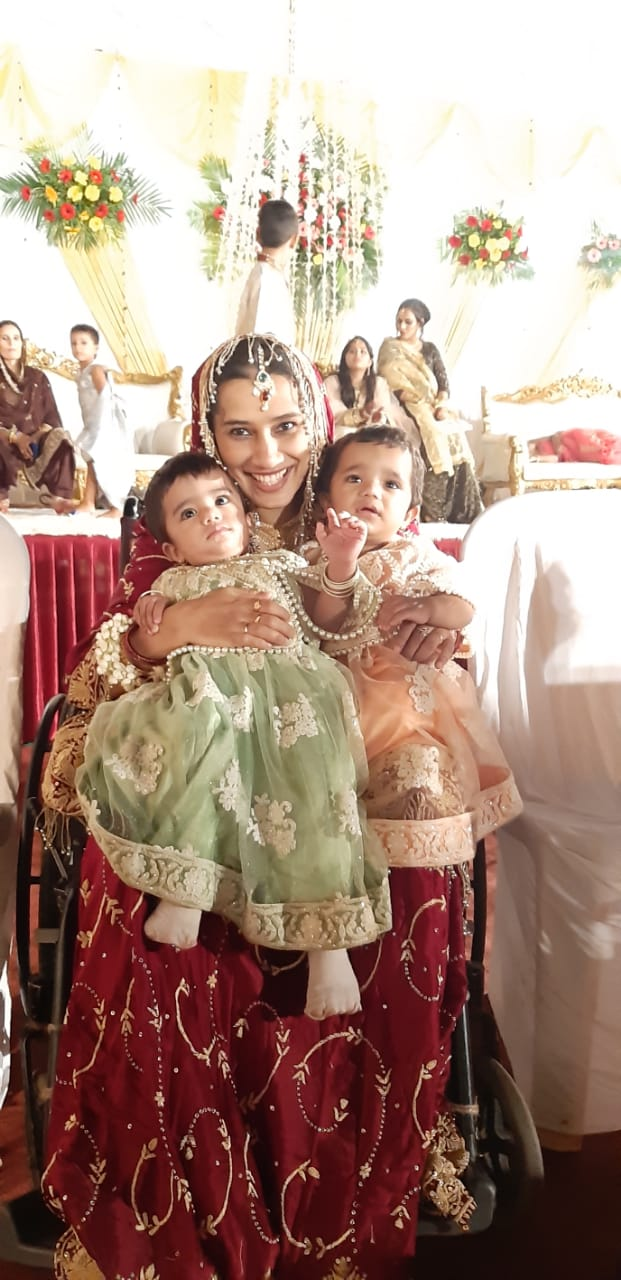 Rafat with her twin daughters