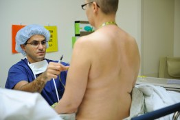 Dr. Allen Gabriel takes measurements and applies markings to Krista Colvin before she undergoes surgery at Southwest Washington Medical Center to remove her breasts and have expanders inserted that will begin the reconstructive process at Southwest Washington Medical Center Friday October 15, 2010 in Vancouver, Washington.