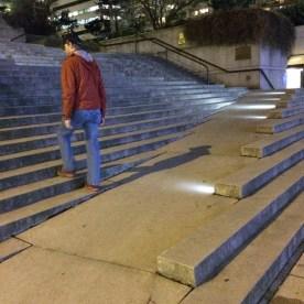 Mark walks up stairs