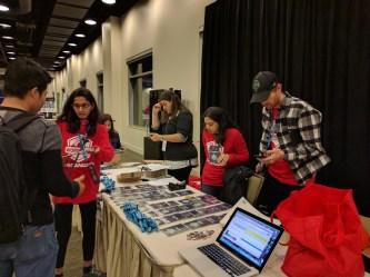 Volunteers help people check-in at WordCamp Seattle 2016