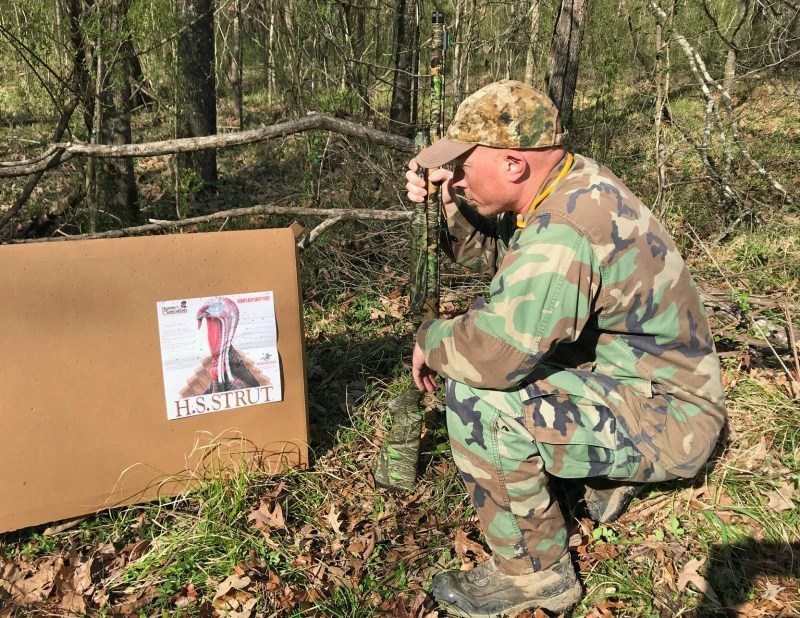 Josh Hawkins checks the pattern his Mossberg delivered at 40 yards. Several loads and shot sizes all patterned well enough to drop a bird.