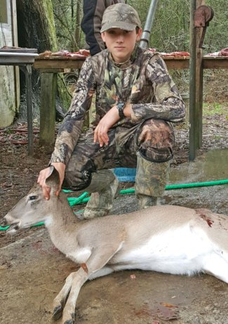 Manning Moody IV, 13, of Wiggins with a doe he killed last season. It was taken in Leakesville.