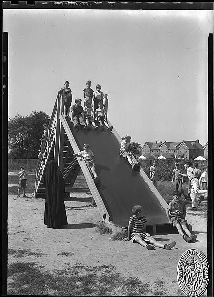 St. Vincent's Asylum - boys on a sliding board. Hughes Studio Photograph Collection, PP 30. Maryland Historical Society