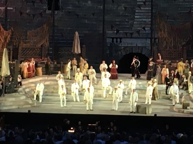 First scene of Carmen at the Verona Arena. The young men waiting for the cigarette girls to appear look like characters from Henry James.