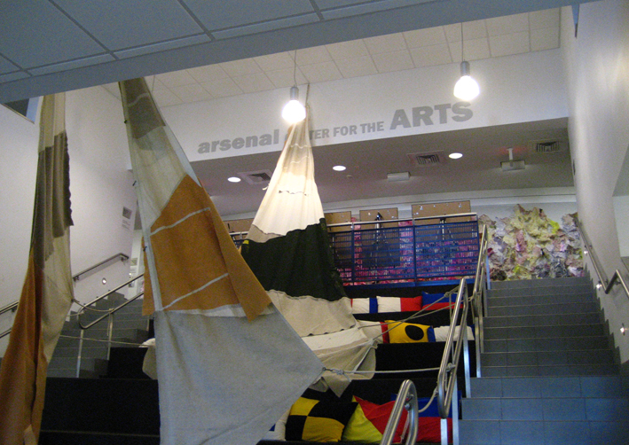 The interior of the Arsenal, looking up the stairs at a crazy sail installation