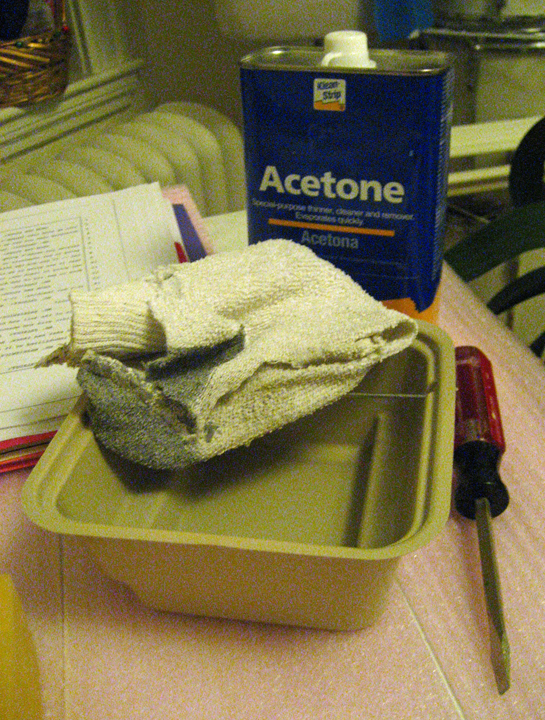 I've found the best way to do this is pour some acetone out in a disposable container, dunk the rag (old sock) in the acetone so it's basically dripping wet and then rub the back of the paper with it--the paper MUST be soaked with acetone for an effective transfer to happen