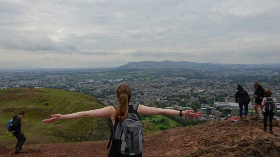 Me at the top of Arthur's Seat with open arms