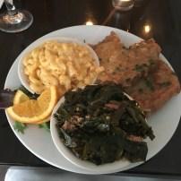 Seared pork chops, collard greens and macncheese