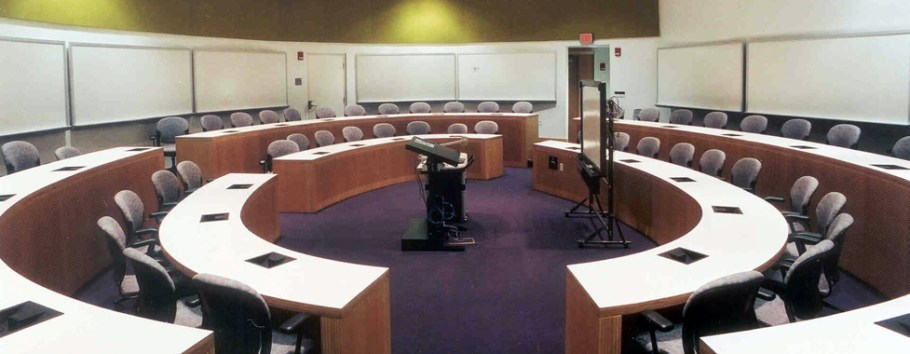 photo of large circular classroom with two concentric tiers of desks