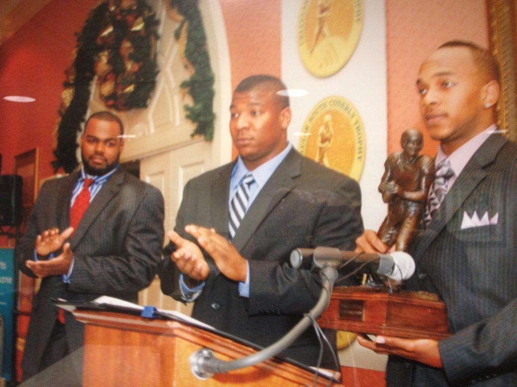Juan Joseph, far right, with 2008 C Spire Conerly Trophy as Mike Oher, far left, and Peria Jerry look on.