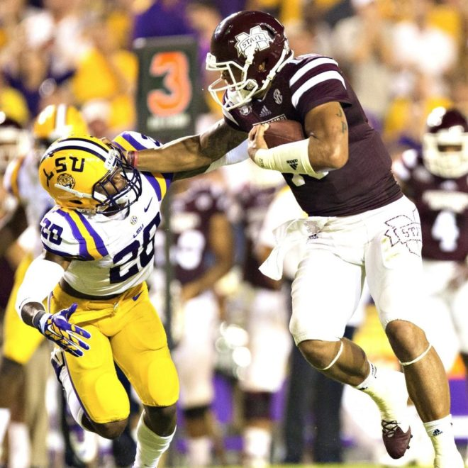 Dak Prescott ran with power, as seen in this run against the LSU Tigers at Baton Rouge.