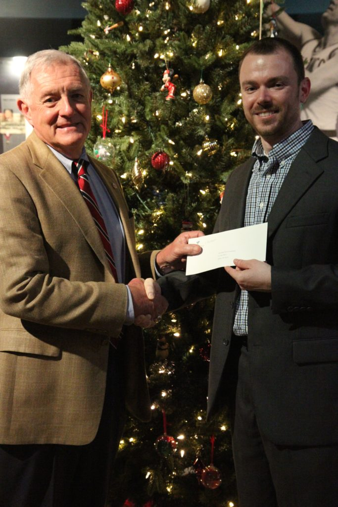 Clarion-Ledger publisher Nathan Edwards, right, presents a check to Bill Blackwell, Chief Operations Officer of the Mississippi Sports Hall of Fame and Museum.