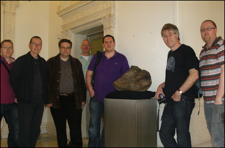BIMS members Barry Lee, Kieron Heard, Mark Ford, David Entwistle, Luther Jackson, Graham Ensor and Martin Goff by the Lake House meteorite.