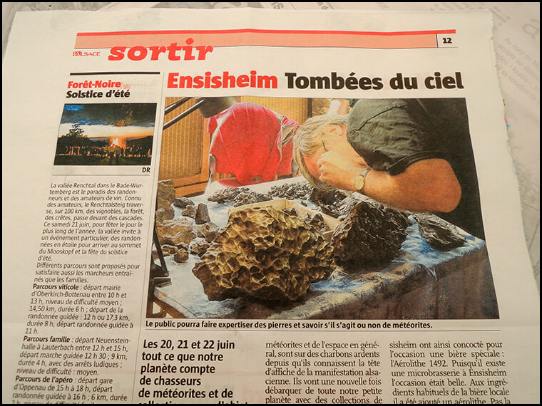 The local newspaper with a photo of Graham poring over space rocks.
