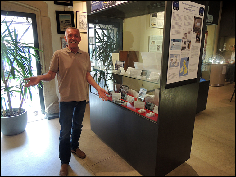Achim Karl in front of our UK and Irish meteorites display.