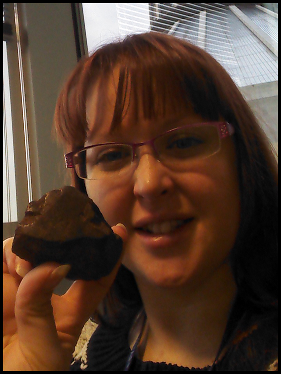 Competition winner Dr. Stacey Habergham with her prize, an NWA crusted fragment weighing 160.g grams