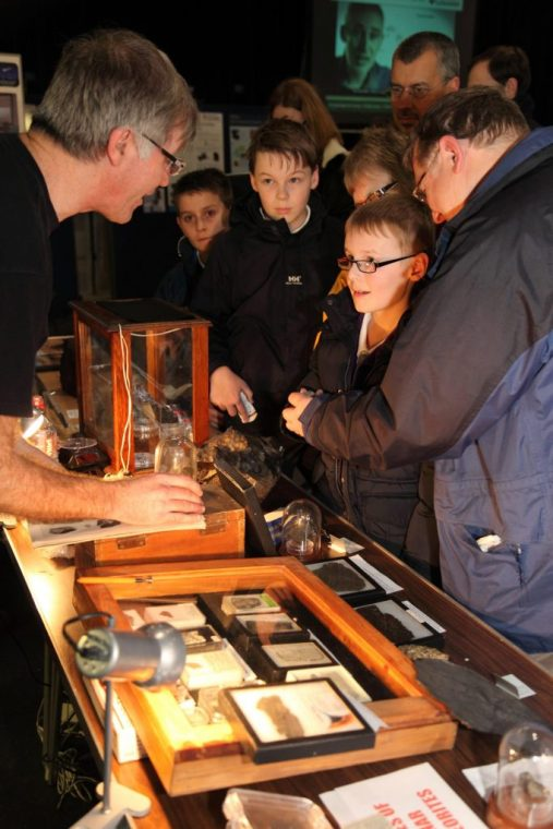 BIMS member Graham Ensor enthralling a young visitor to his meteorite display.