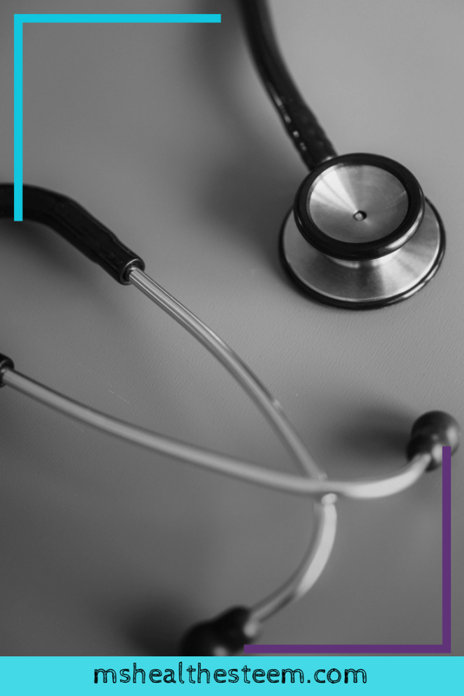 Photo of a stethoscope on a grey background