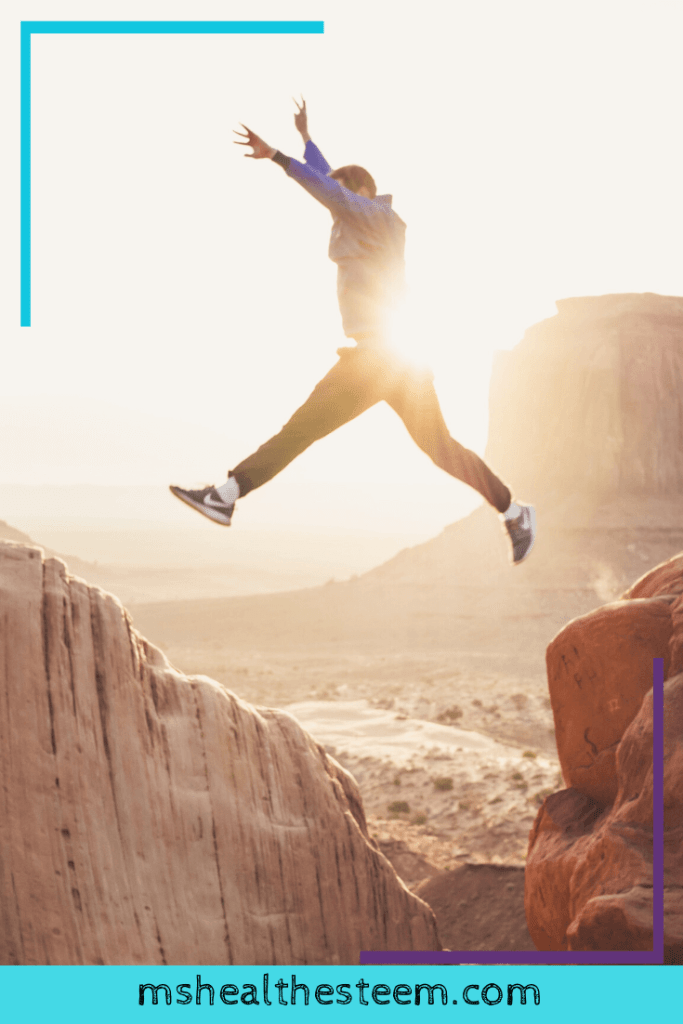 A man jumps from one edge to another. Embracing change is an important part of maintaining a healthy lifestyle.