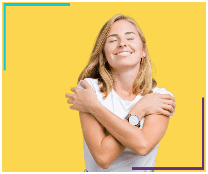 Woman wearing casual white t-shirt over isolated yellow background hugging herself