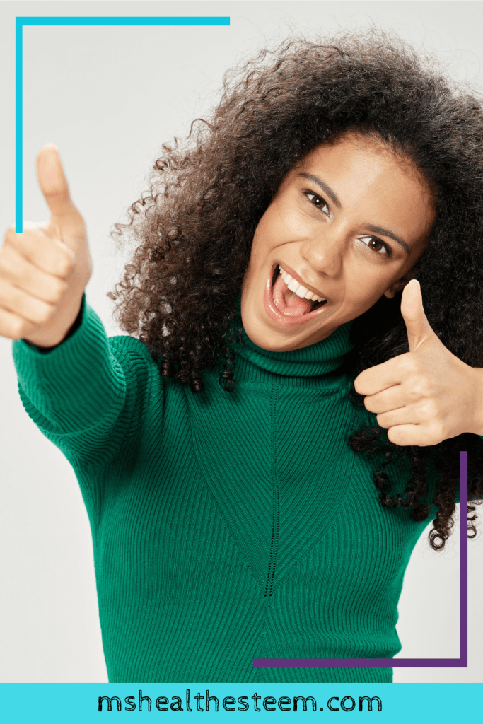 A Woman in a Green Sweater Giving Two Thumbs Up, Reminding You That, No Matter The Outcome Of Your Interview, You're Amazing