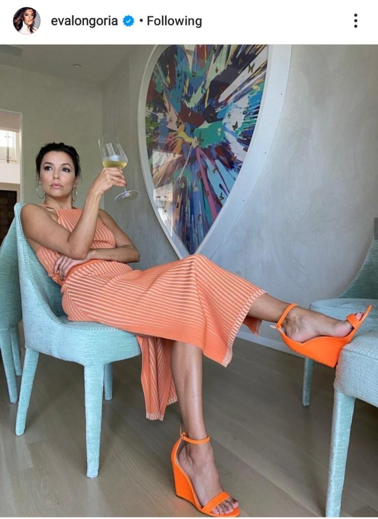 Eva Longoria in collab with Eobuwie orange wedges.