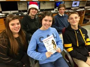 """Sarah with her classmates reading the Ms. In The Biz book """"Thriving in Hollywood!"""""""