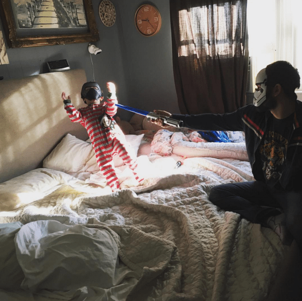 (@RyanSchwartzman defeating baby Kylo Ren on the bed battlefield on this fine weekday morning - @JennicaRenee Instagram