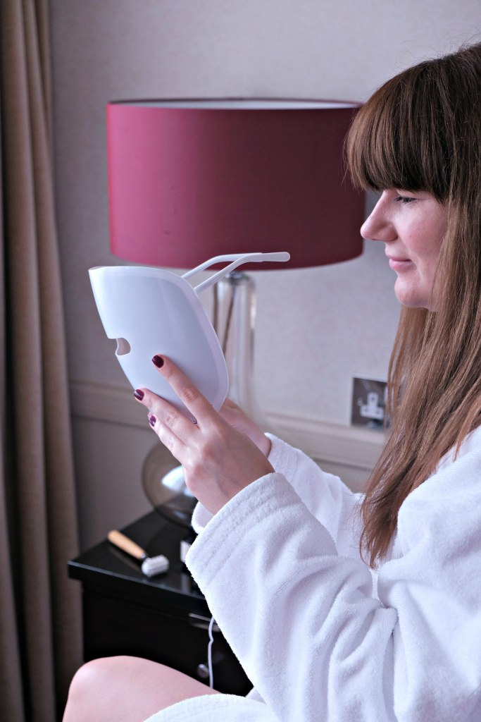 Picture of me holding the Neautrogena Light Therapy mask. Everything I Have Learnt About LED Laser Facials.