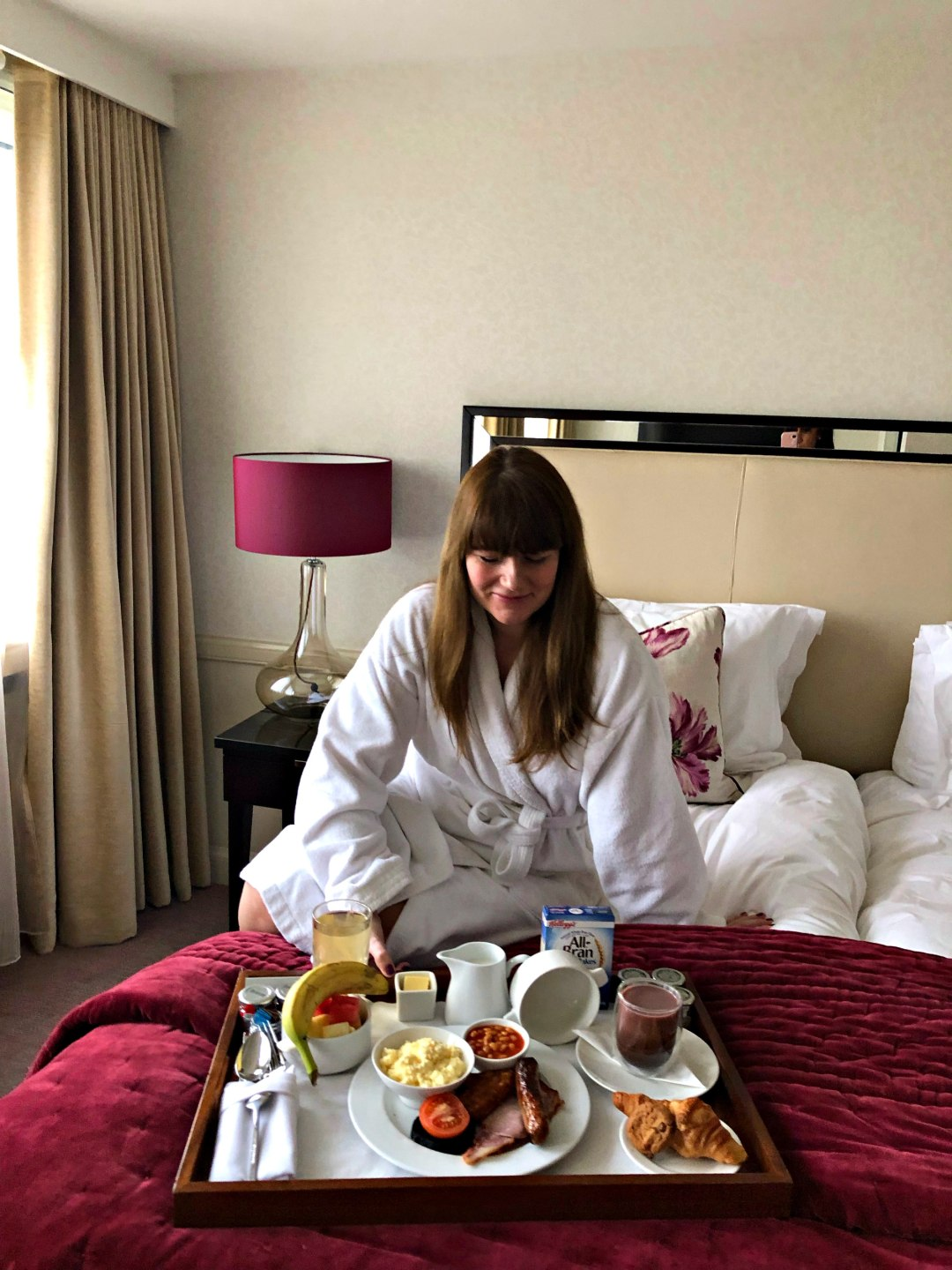 Picture of me on the bed with my breakfast on a large tray!