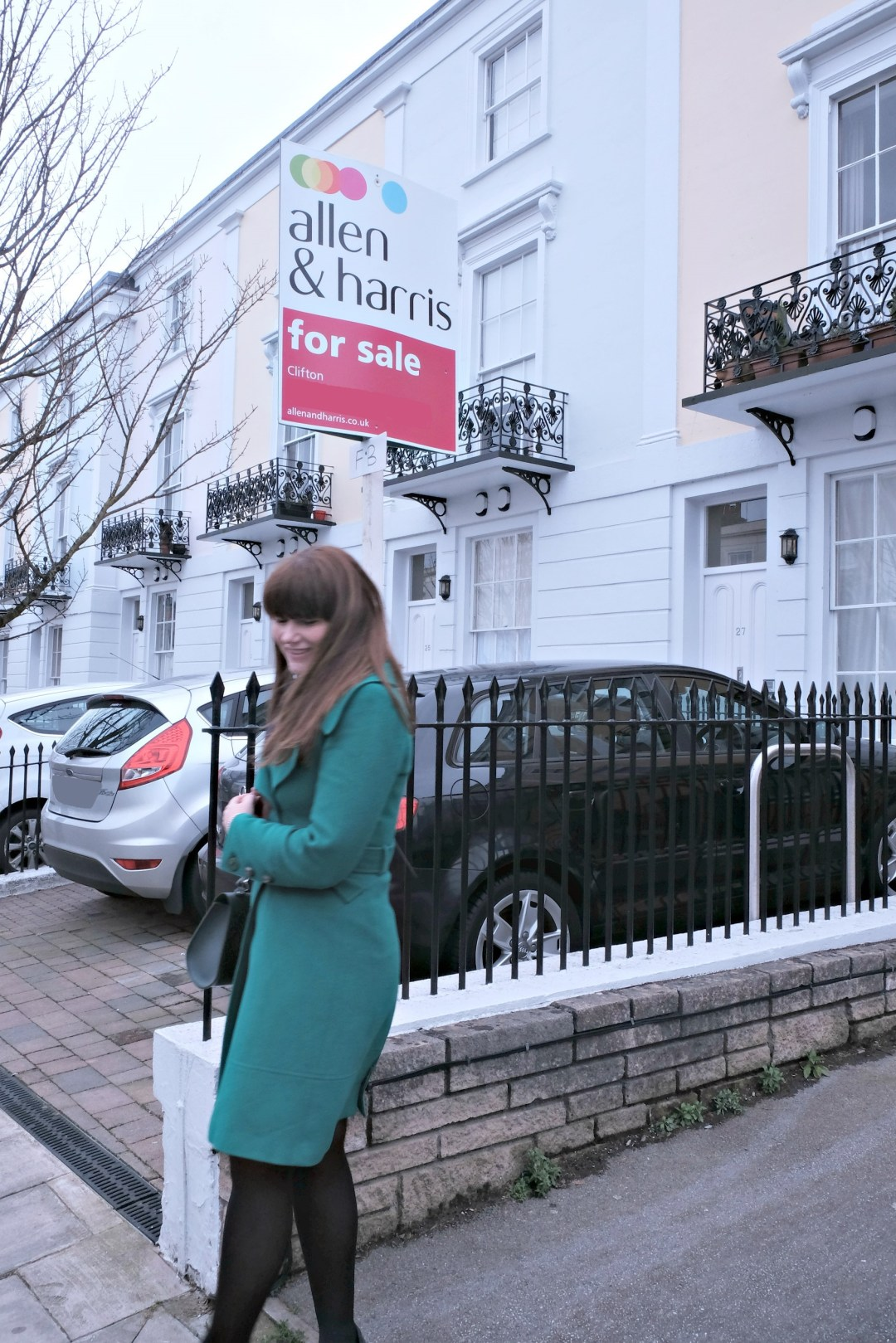 Picture of me in front of a for sale sign for a flat.  Buying a flat in london post.