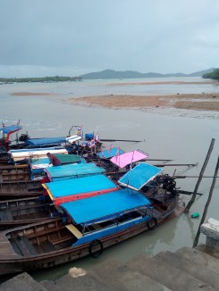 Boats waiting to take diners across the water to the floating restaurant.