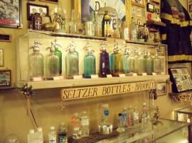 A shelf of seltzer bottles.