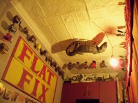 Yes, that is a stuffed crocodile on the ceiling. And yes, those are pencil sharpeners.