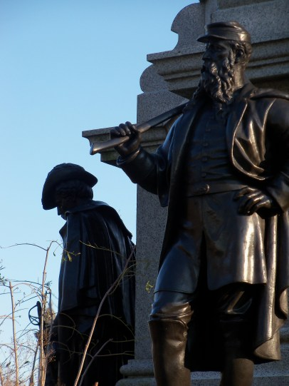 Statues at the base of the monument to the Battle of Brooklyn at Battle Hill, Brooklyn's highest point.