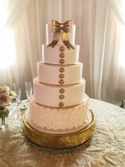 gold bow wedding cake