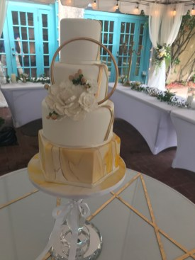 yellow marbled fondant with gold hoop and sugar flowers at Dresser Mansion