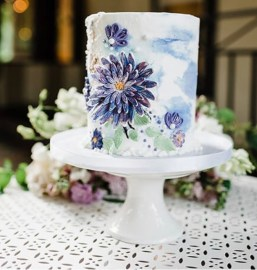 buttercream cake with edible flowers and waterl paining texture