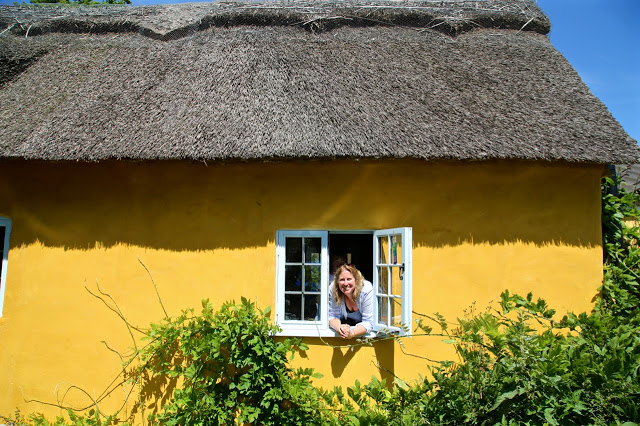 white cottage thatched cottage in norfolk with Charlotte Eve
