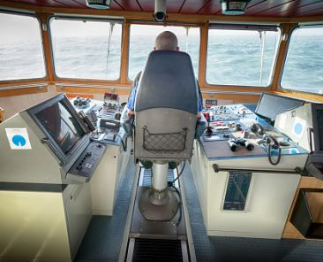 The Captain occupies the Bridge Chair with the vessel on passage
