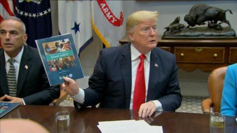 trump with report