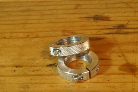 I prefer clamping lock rings, like these from Forster. Those with a set screw can cock when the screw tightens in against the angled threads.